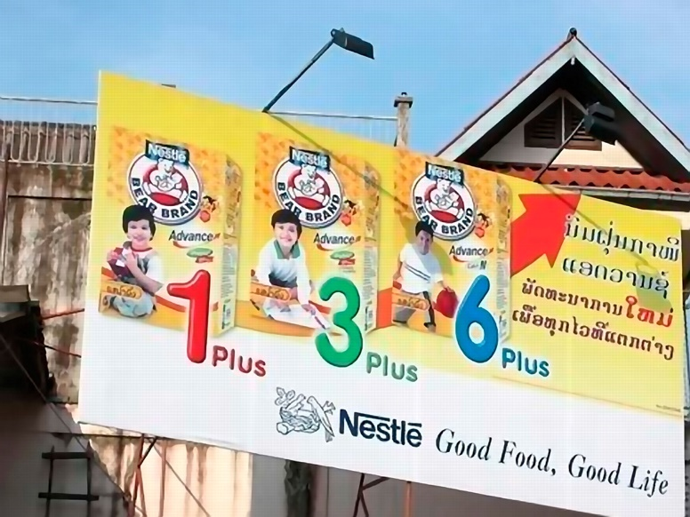 Nestlé billboard in Laos. (Translation: Bear Brand Formula Milk; Advanced; New development; For everyone). Photo: Bryan Watt, Health Frontiers, Laos